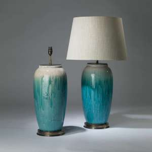 Pair of large ceramic  blue green crackled ombré lamps on round brass bases (T4140)