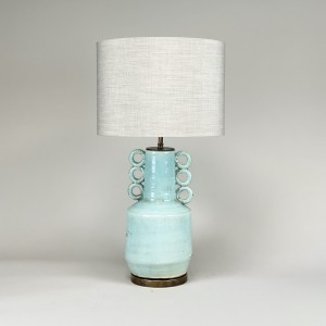Pair of medium ice blue hoop lamps on round brass bases (T4145)