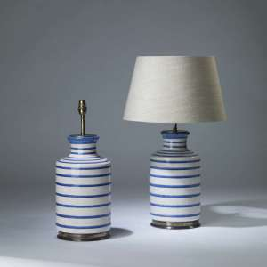 Pair of large white and blue ceramic line lamps on round brass bases (T4171)