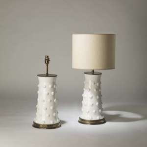 Pair of medium white ceramic 'Dotty' lamps on round brass bases (T4208)