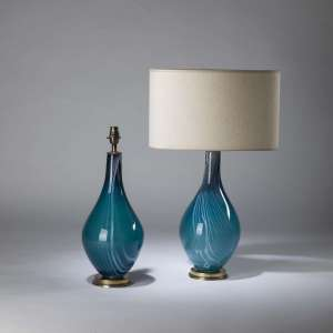 Pair of medium blue & white glass teardrop lamps on round brass bases (T4210)