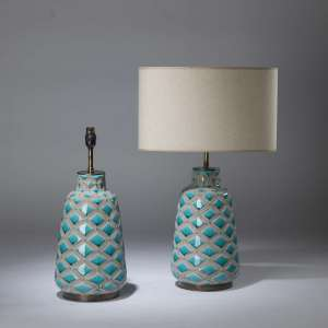 Pair of medium grey blue textured lamps on round brass bases (T4338)
