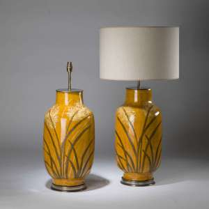 Pair of large mustard yellow meadow lamps on round brass bases (T4340)