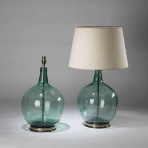 Pair of large green glass 'spencer' teardrop lamps on round brass bases (T4344)