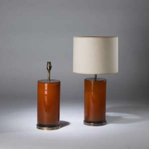 Pair of medium orange red cylinder lamps on round brass bases (T4347)