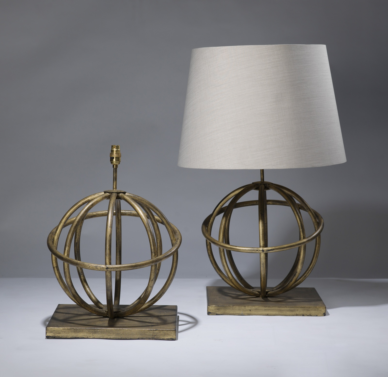 Pair of large globe lamps in distressed gold leaf finish (T3160 ...