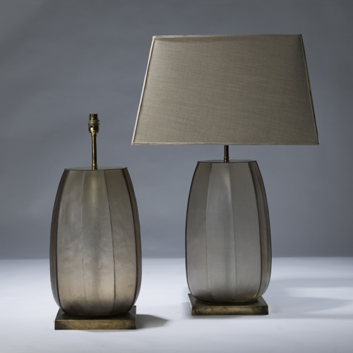 pair of large brown cut glass lamps on distressed brass bases