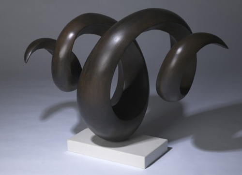 wrought iron 'twist' sculpture in brown bronze finish on marble stand