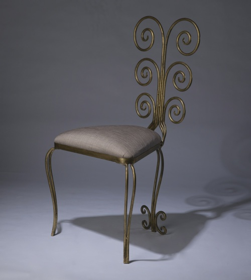 wrought iron 'fountain' chair in distressed gold leaf finish