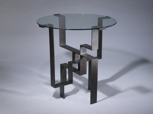 wrought iron 'geometric' centre table in dark brown bronze finish with glass top
