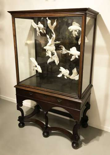 Antique  cabinet with amazing modern ceramic fish
