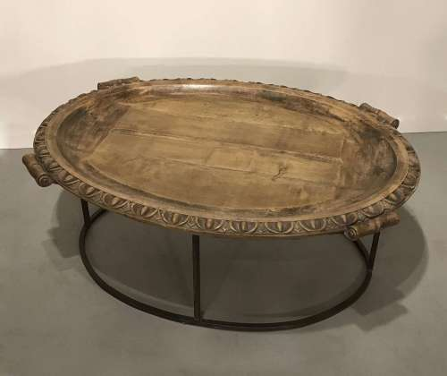 Coffee table made from an amazing massive English Elm platter circa 1820/1840 with a wrought iron base