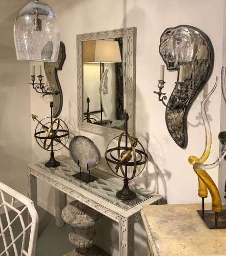 Pair of large mirror backed wall lights