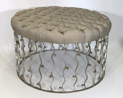 wrought iron ottoman with deep buttoned top and silver leaf finish