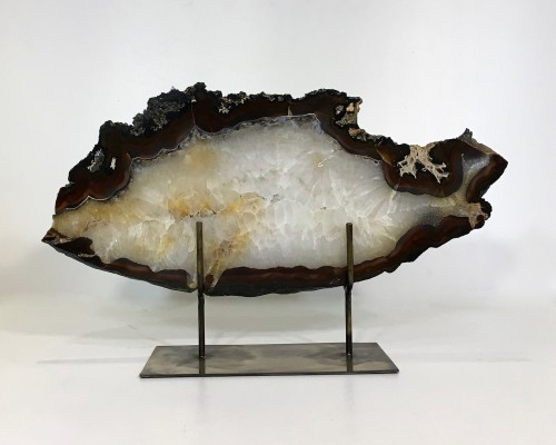 large agate slices on distressed bronze stands