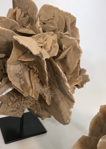 large desert rose sculptures on metal stands