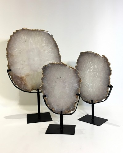 polished clear agate slices with raw edges on metal stands