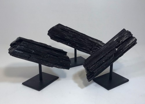 pieces of tourmaline on iron stands