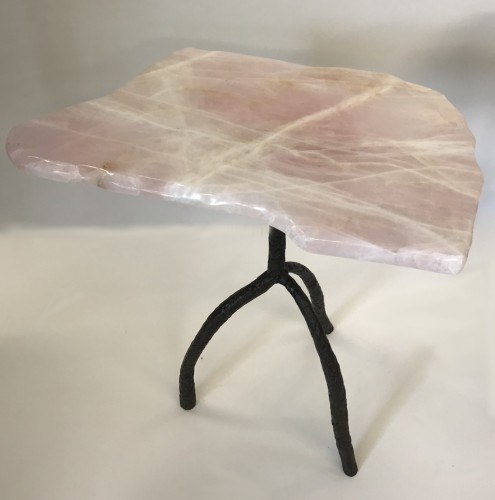 pair of rose quartz tables with textured wrought iron tripod base with brown bronze finish
