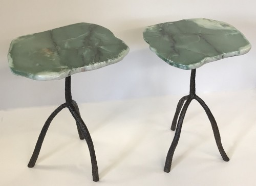 Pair of green serpentine stone side tables on wrought iron tripod base with brown bronze finish