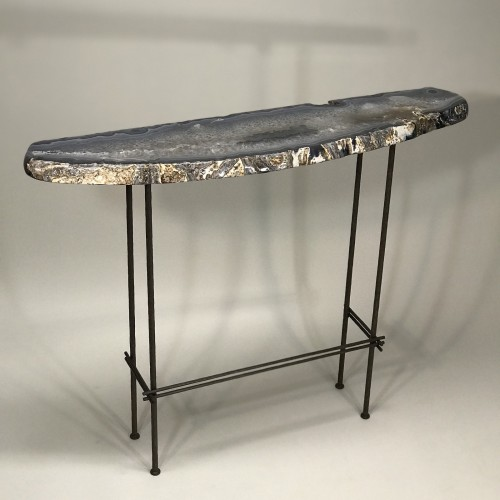 unusual shaped agate topped console on textured stretcher base