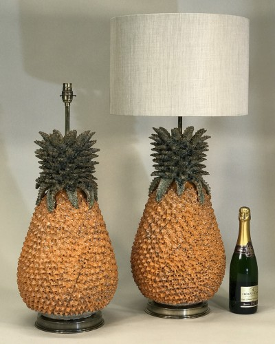 pair of large orange ceramic pineapple lamps on antique brass bases (very heavy)