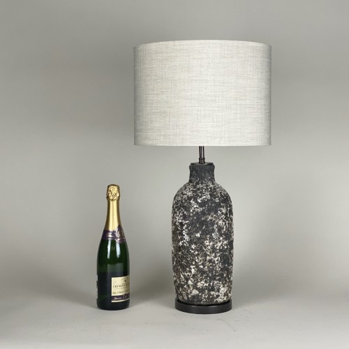 pair of medium textured grey and white lamps with brown bronze bases