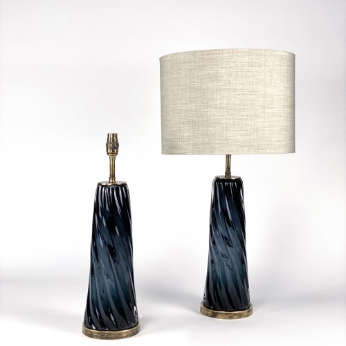 Pair of grey glass swirl lamps on antique brass bases