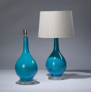 pair of small blue ceramic lamps on perspex bases (T3164)