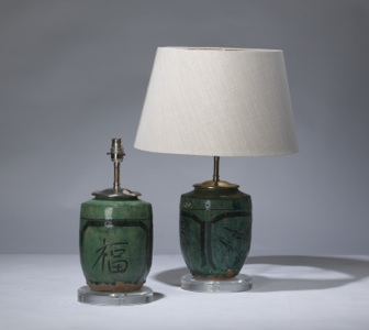 pair of small green antique ceramic lamps on perspex bases (T3189)