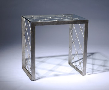 Wrought iron net side table in warm distressed silver leaf finish with glass top (T3401)