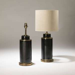 Pair of small black ceramic pot lamps on distressed brass bases (T3723)