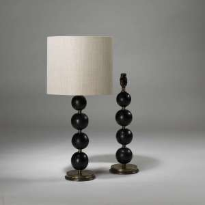 Pair of small black stacked wooden bead lamps on brass bases (T3897)