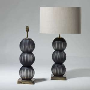 Pair of small black stacked blown glass balls on square brass bases (T3965)