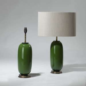 Pair of small green 'peanut' glass lamps on brass bases (T3976)