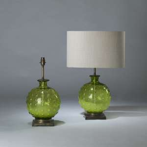 Pair of small green round spotted glass lamps on square brass bases (T4117)