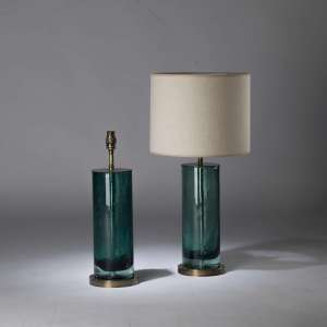 Pair of small green blue glass cylinder bubble lamps on round brass bases (T4380)