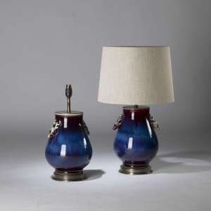 Pair of small blue purple berry ceramic lamps with stag heads on round brass bases (T4402)