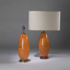 Pair of small orange glass 'almond' dappled lamps on round antiqued brass bases (T4438)