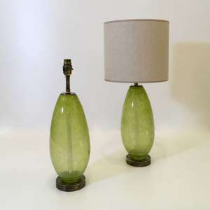 Pair of small lime green glass bubble 'almond' lamps with round antiqued brass bases (T4492)