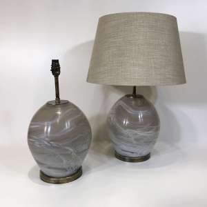 Pair of small glass 'alabaster' effect lamps on round brass bases (T4496)
