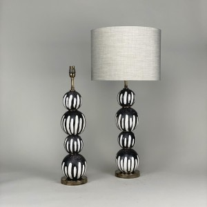 pair of black and white 'drip' stacked ceramic ball lamps with antique brass bases (T5440)